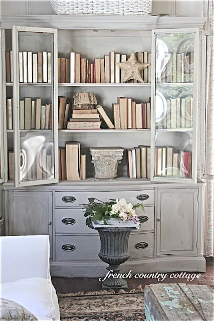 From French Country Cottage: Annie Sloan Chalk Paint in Coco, then layered another coat of paint on it again with Coco mixed with right off the hardware store shelf White.  Interior Country Grey.  Not waxed or stained.