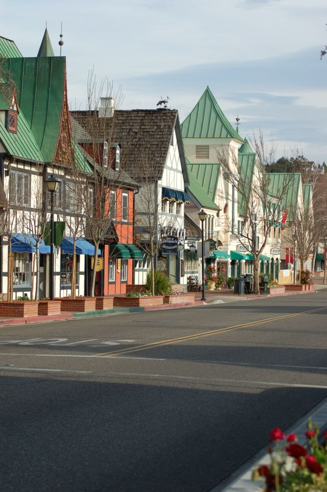 Solvang, California -  brings the old world of Denmark to the state. Population is slightly more than 5,000, but it's a major tourist attraction w/ over one million visitors per year