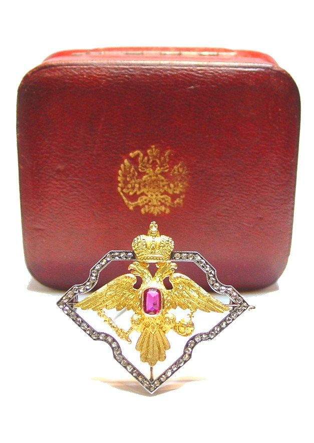 Fabergé. Gold brooch formed as an Imperial Double-headed eagle in the original silk and velvet lined fitted red leather case, its cover gilded with the Imperial eagle. 1908 – 1917.
