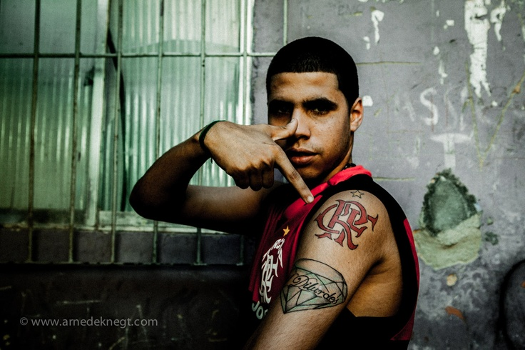proud member of Flamengo's Torcida. Moro Santa Marta, Rio de Janeiro. (c) Arne de Knegt Photography 2012