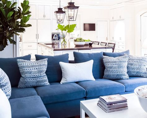 Family Room With Navy Blue Sectional With Blue And White Pillows. J.K.  Kling Associates Interior