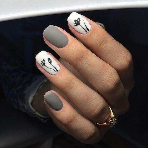 uñas gris blanco diseño flores negras sencill