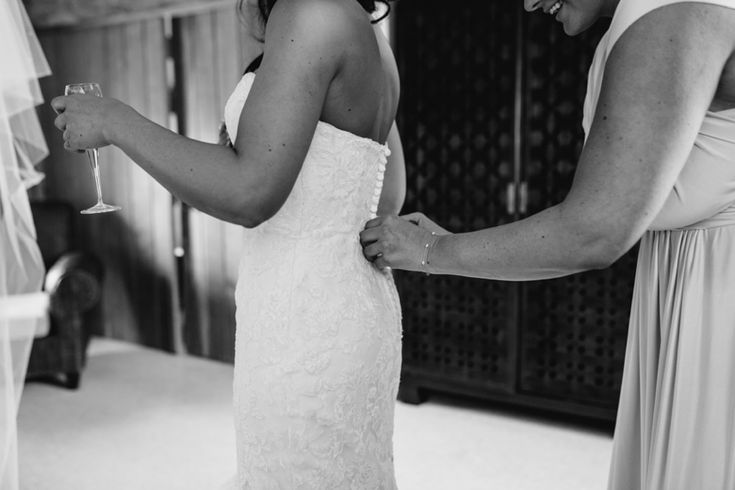 If you have buttons on your dress, make sure you have enough time for your bridesmaid or mother to do them up! It can take a while. Photo by Benjamin Stuart Photography #weddingphotography #weddingdress #buttons #weddingprep #weddingday