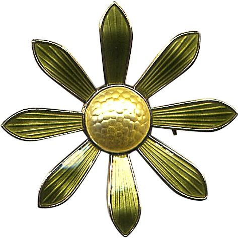 This pretty, two-tone floral pin is a simple, Modernist rendition of a daisy, done with a domed yellow center and long green petals. Both elements are
