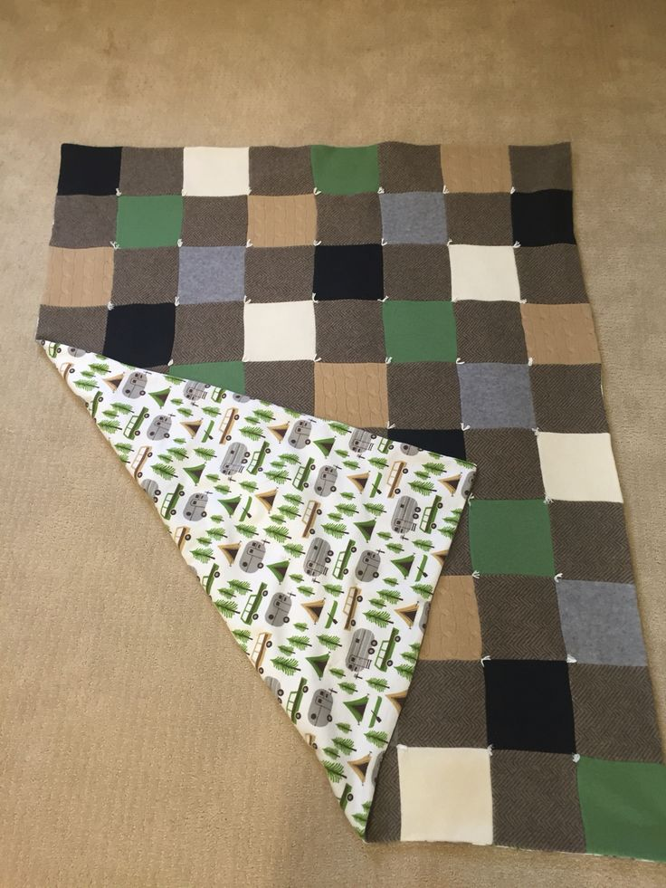 Recycled cashmere sweater quilt backed in flannel and hand tied...
