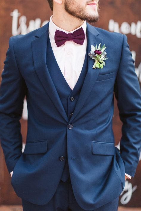 A Navy Wedding Suit With A White Shirt A Burgundy Bow Tie