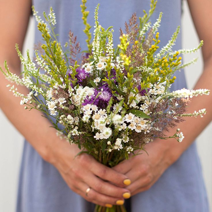 Achillea and wild flowers bouquet