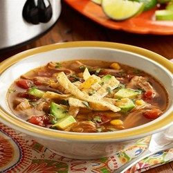 A slow cooker chicken tortilla soup recipe with chicken thighs, Southwest mixed vegetables, zesty tomatoes, spices and fresh lime juice.