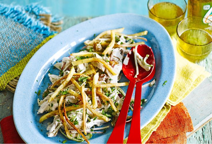 It might seem strange topping a salad with skinny fries but it really works with this creamy chicken salad, which is quite similar to a Waldorf salad.