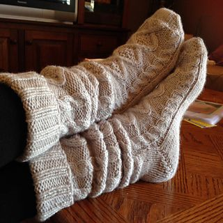 A delighfully cosy pair of cabled house socks in a thicker yarn than what would normally be used for socks