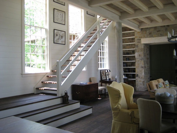 open staircase going downstairs w/windows on the side