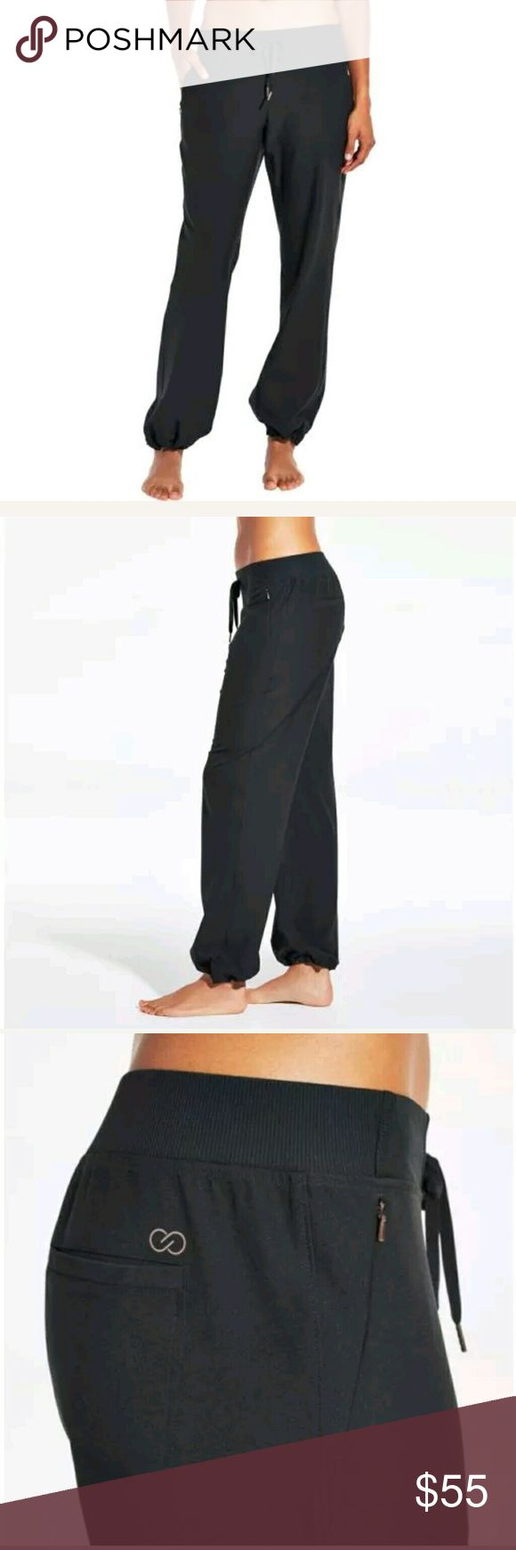 NWT Calia anywhere woven wide leg trouser NWT Calia by Carrie Underwood anywhere woven wide leg trouser in caviar.  Loose fit,  wide leg.  Size large. CALIA by Carrie Underwood Pants Track Pants & Joggers