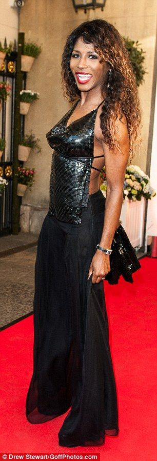 Quirky: Sinitta shunned a dress in favour of wide-legged trousers and a sparkly backless t...