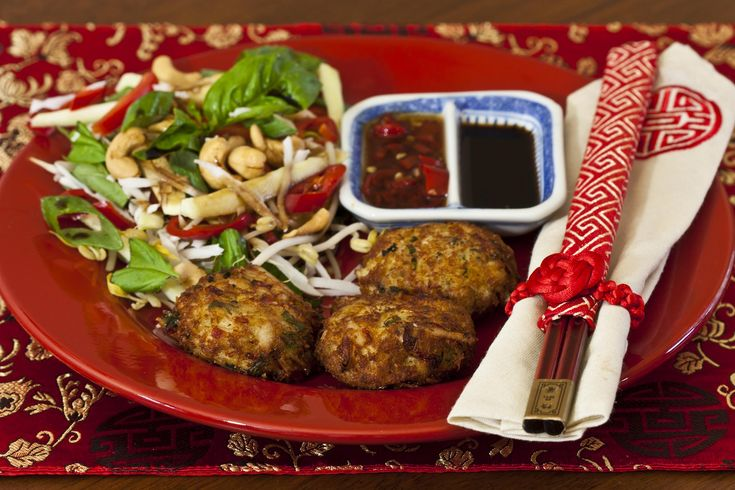 Coconut crab cakes with green mango salad, made with fresh crab meat and served with home made sweet chilli sauce.