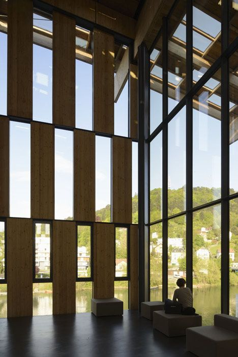 """""""Japanese firm Kengo Kuma and Associates has completed an art and culture centre with a chequered timber facade on the banks of the Doubs river in Besançon, France"""""""