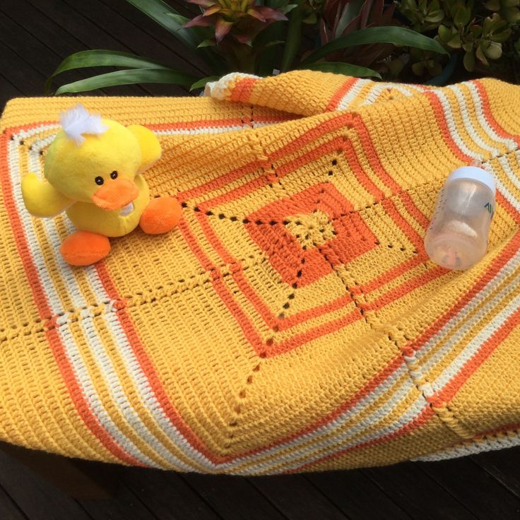 Wool baby blanket in vibrant colours available to ship worldwide