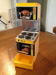 Sindy doll Magic Cooker which featured light and sounds. Each item placed on the hob made an appropriate noise, there was a hissing pressure cooker, a whistling kettle, a crackling frying pan and a bubbling vegetable pan. The rotisserie had a light and the oven had a light and timer.