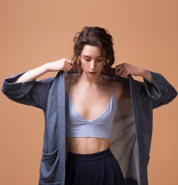 Odeyalo-bloom-kimono-blue  Here's another versatile piece that can be worn in a casual or chic way, depending on your mood.  The minimal cut, the soft inside and the oversized pockets are the perfect mix of comfort and functionality.  Wear it over your favorite dress or top.  The lightweight fabric and the denim color will remind you of your favorite denim jacket!    The model is 5'8″/173 cm and is wearing XS/S  54% polyester/46% cotton french terry  Designed and made in Montreal.