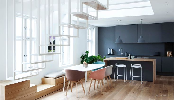 Nordic home with floating staircase.