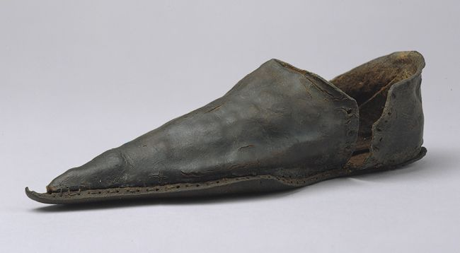 This shoe, part of a larger collection of objects excavated from an archaeological site on the Thames River in London, provides a glimpse of the fashionable shoe style for men from the fourteenth to the mid-fifteenth century.