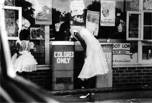 Discrimination! The Blacks have to drink from their own water fountain. (for the colored people)