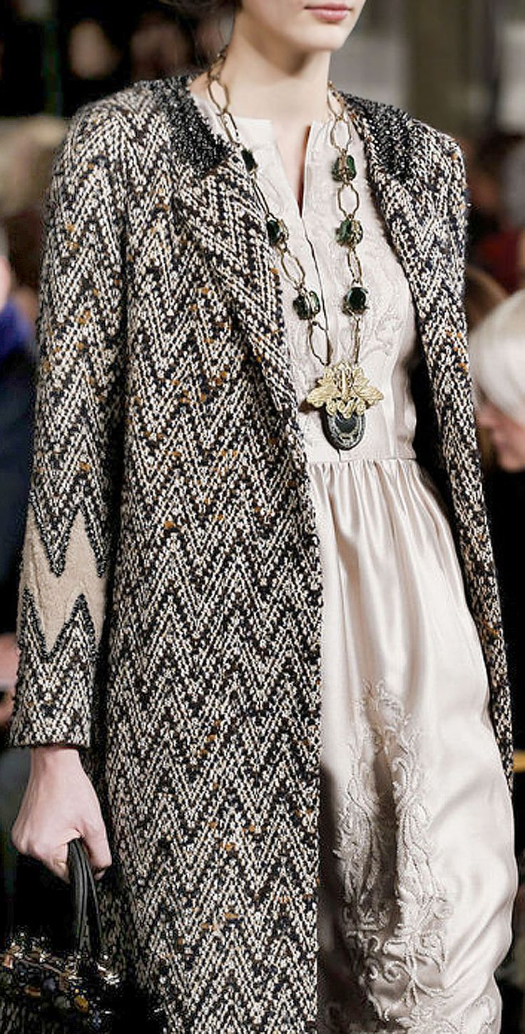 Thick beaded coat and statement necklace over a negligee-light dress. (Chanel)