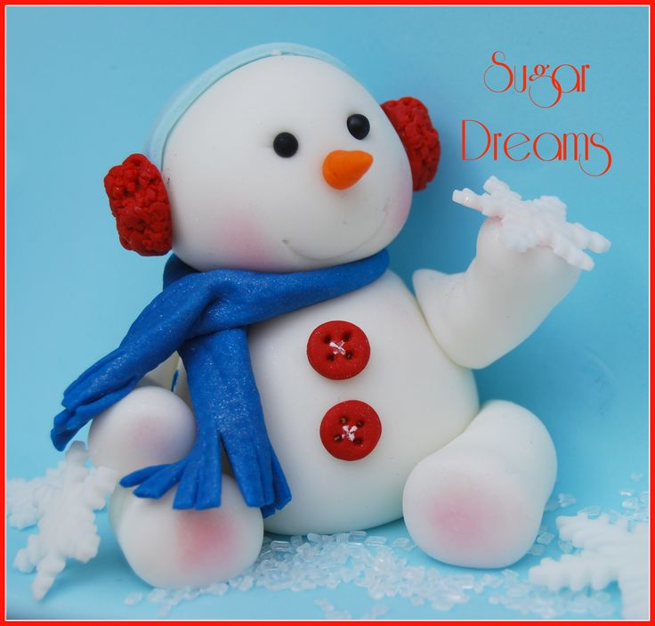 Christmas - A cute snowman .....we made it with fondant !!!!!  Could be done with sculpey clay too...