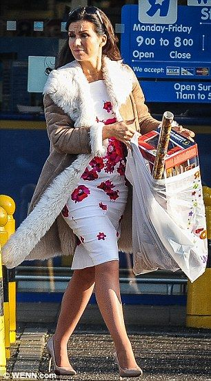 Shopping in style: The mother-of-three stepped out in a white floral dress under a sheepsk...