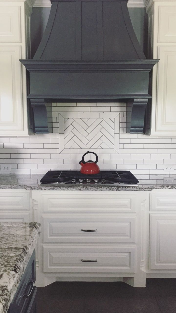 Herringbone kitchen tile backsplash white cabinets interior design