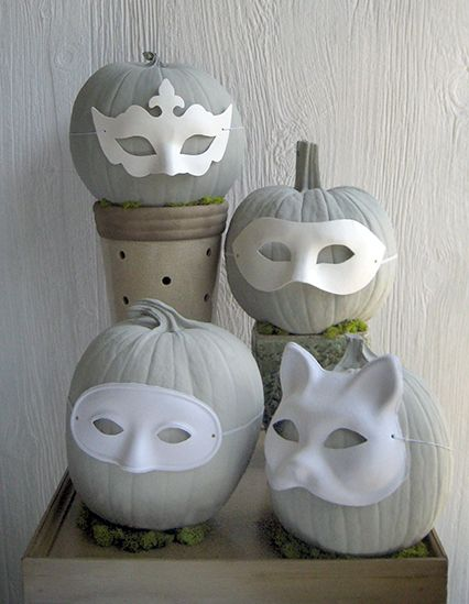 grey painted pumpkins with white painted masks. I think I'd leave them orange…