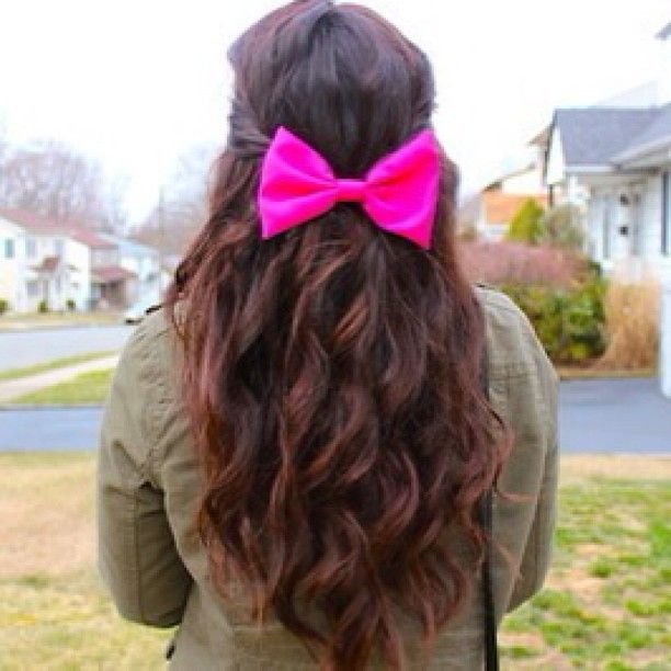 curls and a neon bow