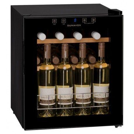 Racitor vinuri cu compresor DX-16.46K Racitorul de vin Dunavox DX-16.46K este o apariţie elegantă de culoarea neagră, usă de sticlă colorată, care fac ca acest răcitor să devină perfect pentru prezentarea vinurilor în restaurante, sau in bucătării moderne.