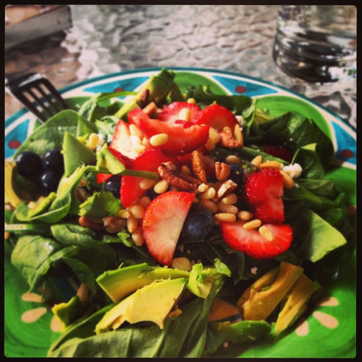 Berry salad... Spinach, goat cheese crumbles, strawberries ...