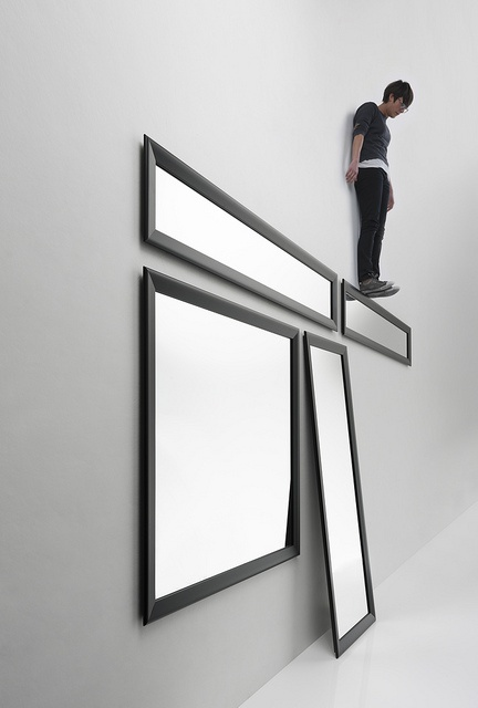 Black Yume / Design: StH, 2011 / Yume mirrors can be hung horizontally, vertically, or in larger sizes, placed on the floor. Yume mirrors are presented with two frame versions, namely, polished aluminium and black oxidated, making the collection suitable for any environment, both domestic.