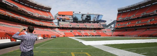 A member of the media takes some photographs at Cleveland Browns' FirstEnergy Stadium August 22, 2014 during a media tour of the renovations made by the Browns. (John Kuntz / The Plain Dealer)