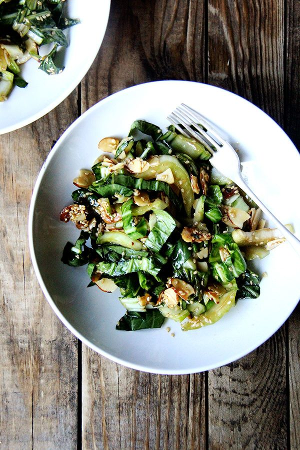 Bok choy salad is excellent as its crunchy stalks and sturdy leaves are capable of enduring a bold, salty-sweet dressing. A slightly sweet dressing, in fact, is just what slightly bitter bok choy needs. The most fun part about this recipe, however, is the sesame-almond crunch, a mix of melted sugar, toasted almonds and sesame seeds, that comes together in a flash and disappears about as quickly.
