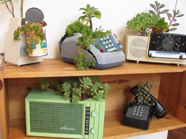 24 Whimsical DIY Recycled Planting Pots on the Cheap .... how cute is this?! would love to do one of the telephones, or adding machine for an office...but the succulent in the can on the can opener is too cute!(great gift for newlyweds!)
