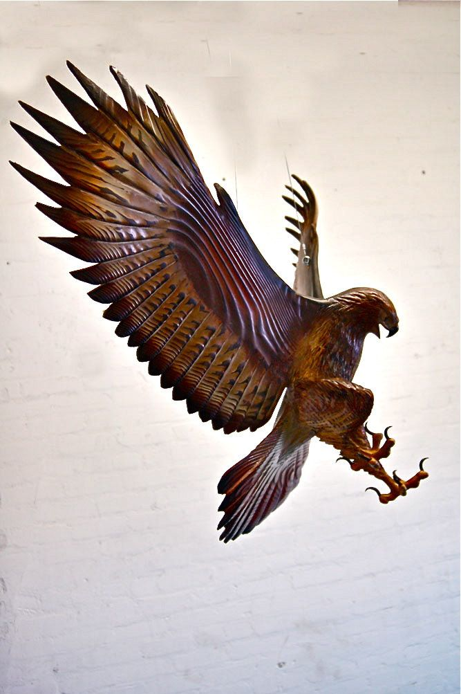 Amazing use and understanding of wood - and raptors ! got to get me one of these sometime ?  Attacking Hawk Wood Sculpture by Jason Tennant by jasontennant