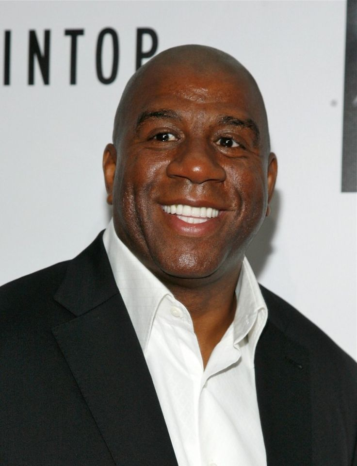 Magic Johnson, businessman, true owner, nba champion, leader, unstoppable force and true lakers legend and icon of all ages #32. I met him at a Lakers press conference.