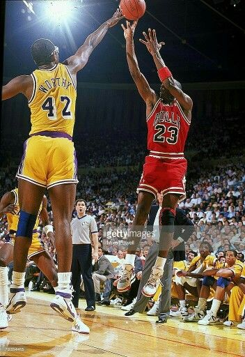 The GOAT shoots over former Tarheel teammate and Laker legend James Worthy in L.A.