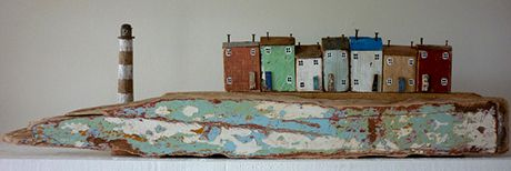 artist: kirsty elson. Art: Terraced houses and lighthouse on cliffs
