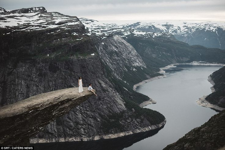 The last couple on earth: The epic vista at Torlltunga in Norway conveys sense…