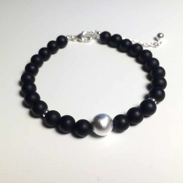 Bracelet with matte black onyx gemstone beads and 925 sterling silver details by PenelloJewelry on Etsy https://www.etsy.com/listing/259917737/bracelet-with-matte-black-onyx-gemstone