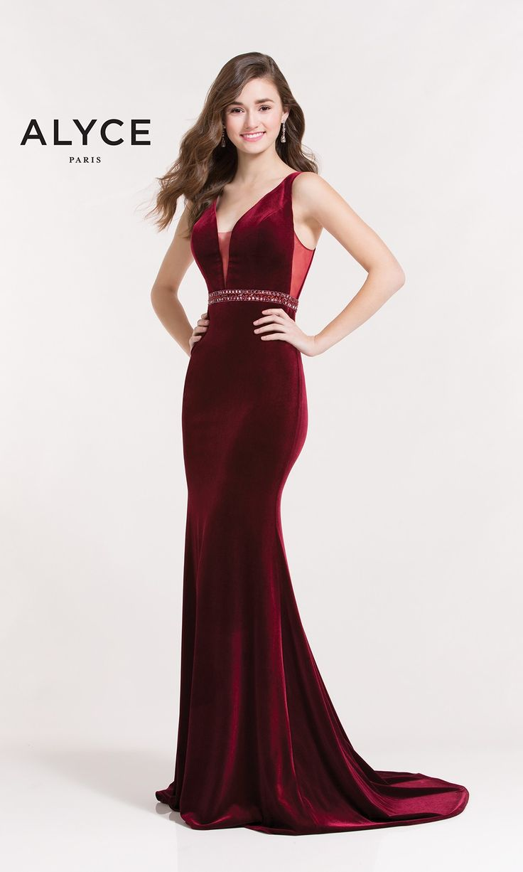 Slim velvet dress with side cutouts, a deep v neckline with an embellished belt at the waist and open back.