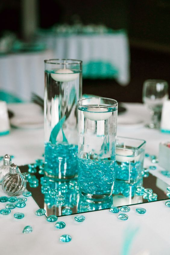 Teal Glass Pebbles Candle Centerpiece / http://www.deerpearlflowers.com/floating-wedding-centerpieces/2/
