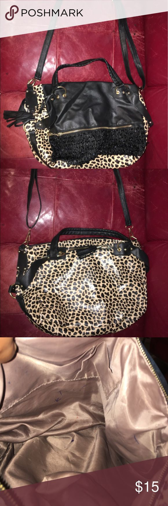 Animal Print Shoulder Bag Beautiful large animal Print Shoulderbag brown tan black and gold with beautiful tassel zipper pulls Flaws::: Has ink marks inside see photos reflex in price Bags Shoulder Bags