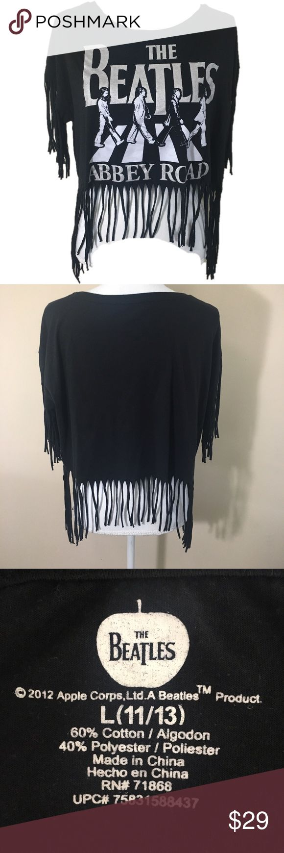 "The Beatles Abbey Road Fringe Shirt Sz 11/13 Large The Beatles Abbey Road Fringe Shirt Sz 11/13 Large. Total Chest 49""  Length from Neck to Start of Fringe 14.4"" Apple Corps  Tops Tees - Short Sleeve"