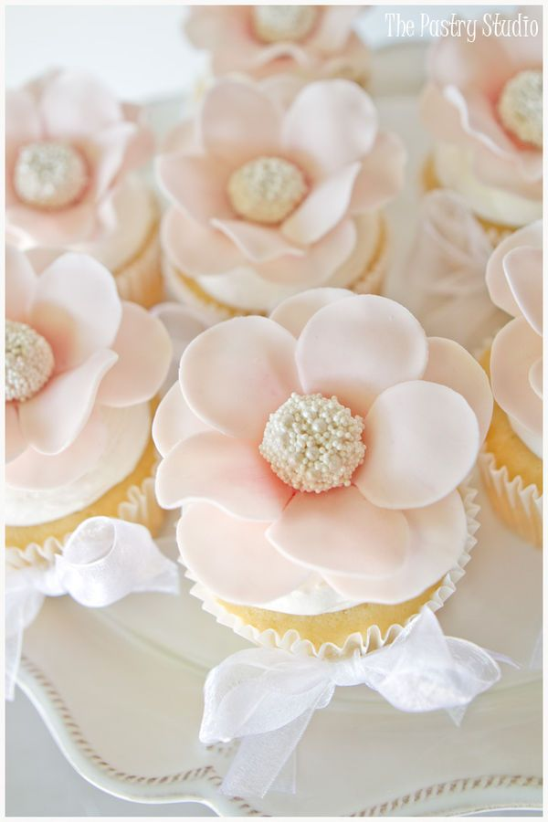 Floral cupcakes with pearl centers to complement the soft color palette from Design-Seeds.com