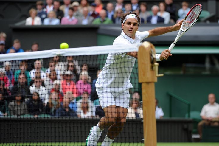 Roger Federer hits a forehand volley during his fourth round match against Xavier Malisse. - Matthias Hangst/AELTC