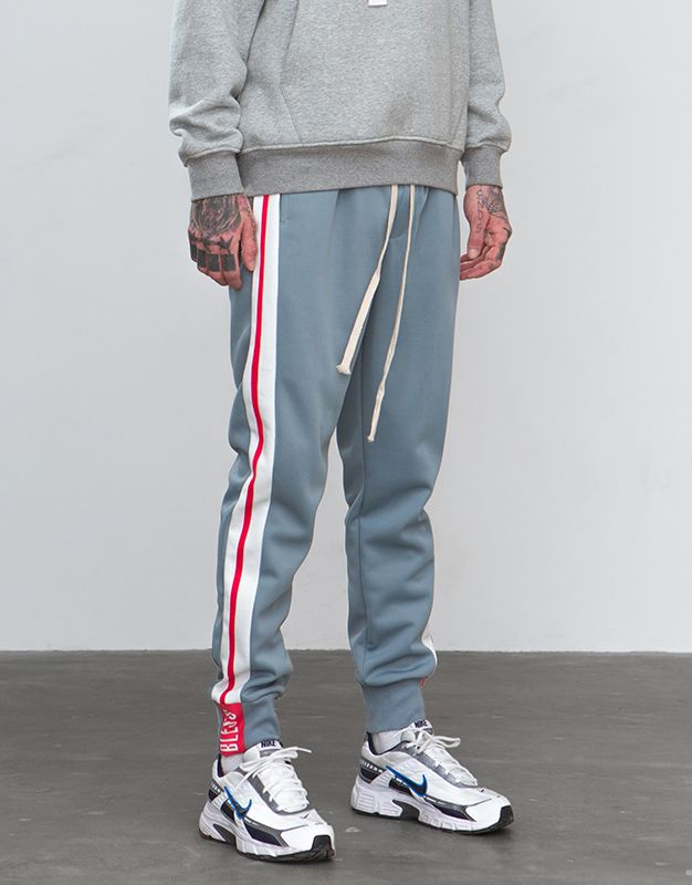 cd7308fe11c9 Sweatpants ft White   Red Side Stripe Elasticized drawstring waistband with  mock fly. Side pockets
